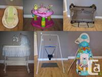 Baby bassinet with baby mobile that plays music, lights