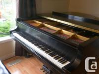 7' concert grand piano with powerful sound. Produced in