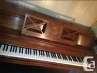 Baldwin upright piano in beautiful deep cherry