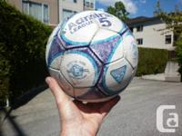 SOCCER AND FOOTBALL  soccer ball. bit rough but useable