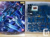 Several Bandai MG Gundam models for sale. All are not