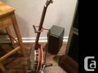 Offering a 6- string banjo/guitar, Baron brand, with