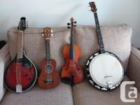 Well used violin and banjo with case. $50 each Nearly