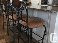 A total of 8 ornate bar stools. $75.00 Each, sale must