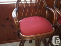 2 beautiful Ratana bar or kitchen stools. They swivel