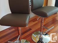 Barely used adjustable Bar Stools with Chrome foot