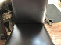 Two mocha brown bar stools. 111� tall 46 � wide Cat