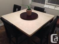 I have a 4' square bar style dining set. It is a deep
