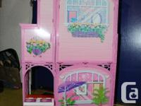 Small barbie beach house. Comes with bed, couch, TV,