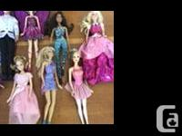 Bundle of 12 barbies! Comes with a car, horse, bike and