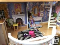 With dolls, clothes, furniture and accessories Good