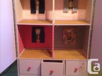 This house fits barbie dolls! It's handmade so it's one