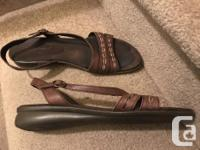 Brown leather sandal has been worn and cleaned in