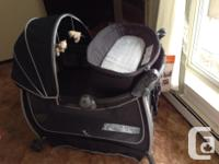 The Eddie Bauer Complete Care Playard features a