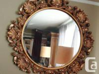 This is a stunning mirror crafted in a Baroque style.