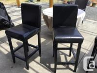 4 Black barheight stools, bonded leather. Two are in
