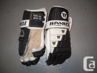 Available for sale: Winnwell grown-up hockey gloves-