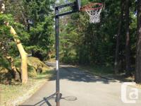 Adjustable Quickcourt hoop. Goes from small to full