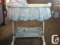 Bassinet with lower shelf. Has music, nightlight, and
