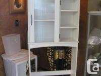 Over the commode bathroom hutch. White with good extra
