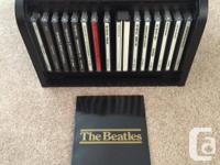 Comes with all 13 Beatle albums and description card in