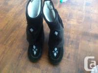 I have beautiful black mukluks with fringe design on