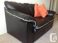 Black leather love seat for sale.  In good condition