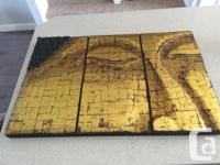 Beautifully hand-crafted picture of a golden Buddha
