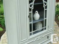 This china cupboard would certainly look great in any