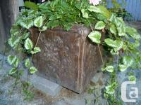 This is a beautiful planter with flowers measures: