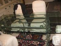 This is such an original glass table with Antique cast