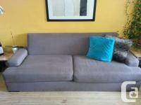 This is a soft, lovely, grey West Elm couch that is 6