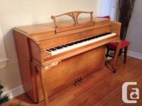 This beautiful hand-carved Story & Clark piano was