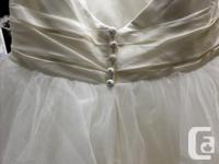 Beautiful Jasmine Wedding gown. Featured on the cover