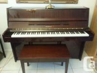 """kawai CE7N 43"""" console piano. Mahogany satin fnish."""