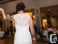 Beautiful ivory lace wedding dress with button up back.