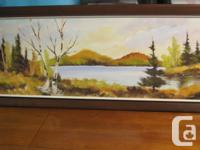 This is an oil painting of a lake by canadian artist