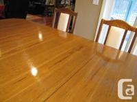 Solid oak quality made Dining set. Table has a 2 ft.