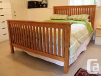 I have a beautiful solid oak Mission style bed frame