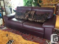Beautiful new High end Natuzzi leather couch, plum