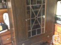 Marketing a lovely aged wood china closet. It's in