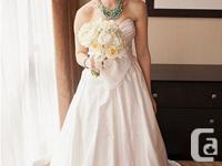 This is a gorgeous Paloma Blanca wedding gown, which