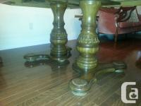 Double pedestal base dining room table which is also
