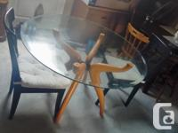 It's a beautiful table comes with 2 chairs Its round