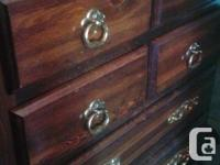 THIS SOLID OAK 7 DRAW DRESSER HAS 4 SMALLER DRAWS AND 3