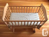 Beautiful solid wood bassinet with 3 fitted sheets.