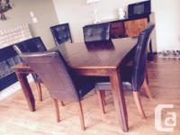 Stunning dining room suite. Includes solid wood table
