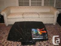 This is a beautiful square black marble table with