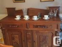 For Sale is a wonderful Oak Sideboard or buffet. Circa