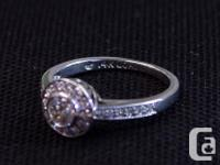 This beautiful engagement ring is white gold with a